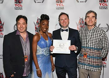 Arek Zasowski with an actress Aemy Niafeliz, and with Jon Grusha and Peter Greene, the Golden State Film Festival Organisers at the festival awards ceremony at the TCL Chinese Theatre in Hollywood